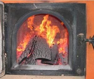 Топить печь во сне дровами